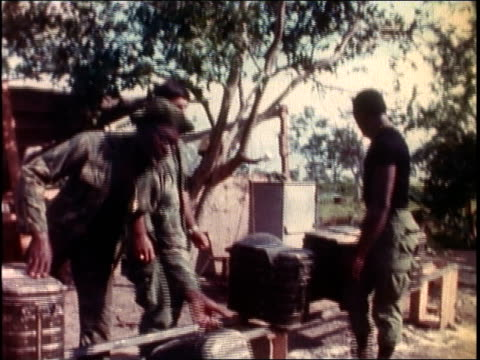 1960s montage us army soldiers stockpiling jerry cans and ammunition / vietnam - ammunition stock videos & royalty-free footage
