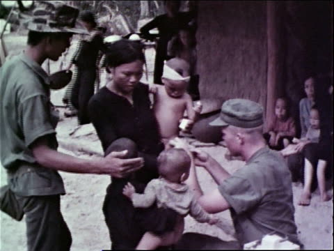 1960s montage us marine corps medics provide first aid and health care for civilians / vietnam - medical dressing stock videos & royalty-free footage