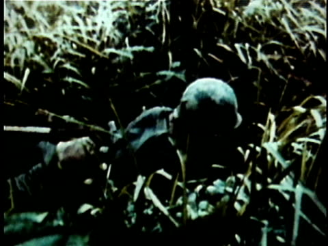 1960s MONTAGE US soldiers in jungle combat aiming and shooting guns during the Vietnam War / Vietnam