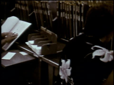 1960s montage women going through books, making notes / baltimore, maryland, united states - social security stock videos & royalty-free footage