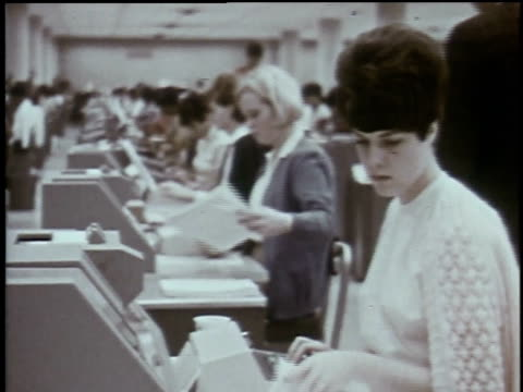 1960s montage women typing at desks, as supervisor watches them / baltimore, maryland, united states - 社会保障点の映像素材/bロール