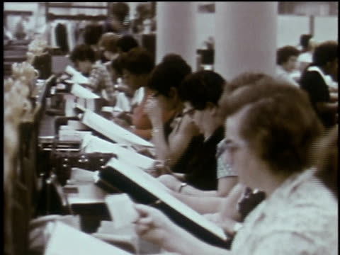 1960s montage women working with files and looking at microfilm on screens / baltimore, maryland, united states - 社会保障点の映像素材/bロール