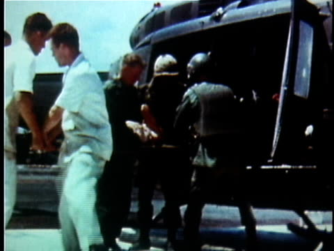 vídeos y material grabado en eventos de stock de 1960s montage wounded us soldier being stretchered off helicopter and transferred to hospital / vietnam - víctima de accidente