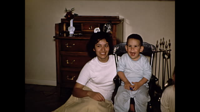1960s Mother poses with sons by chimney - Home Movie