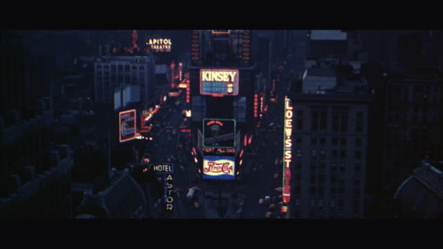 1960s ws ha neon signs in times square / new york city, usa - letterbox stock-videos und b-roll-filmmaterial