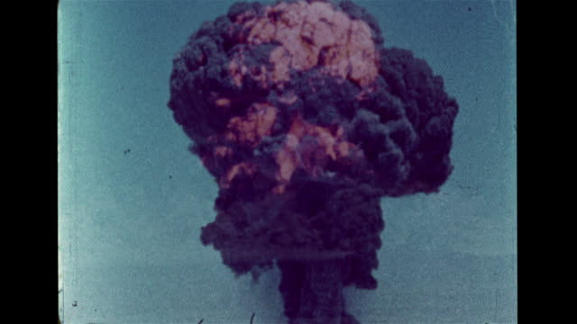 nuclear weapon hd vs hydrogen thermonuclear bomb exploding mushroom cloud black smoke rising into atmosphere hbomb cold war atomic radiation fallout - atomic bomb stock videos & royalty-free footage