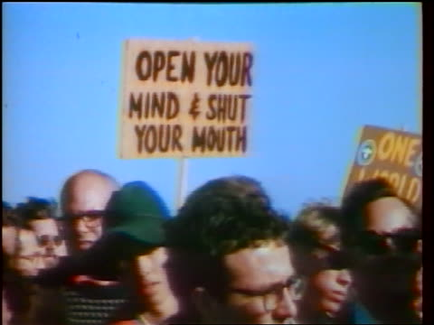 1960s open your mind shut your mouth one world signs being held above heads at demonstration - peace demonstration stock videos and b-roll footage