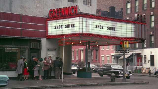 1960s WS People waiting in line outside movie theater