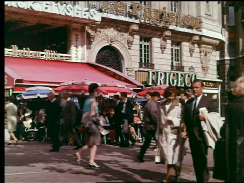 1960s people walking on sidewalk next to outdoor cafe + stores / paris, france - retail place stock videos & royalty-free footage