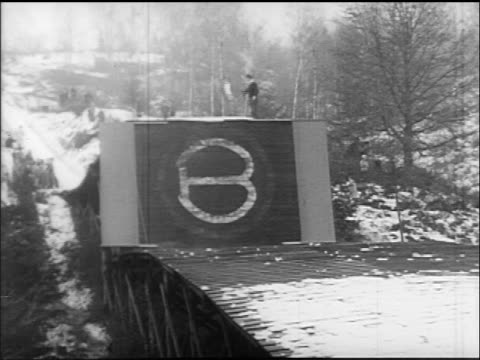 b/w 1960s person waving flag by ski jump / germany / educational - nur männer über 30 stock-videos und b-roll-filmmaterial
