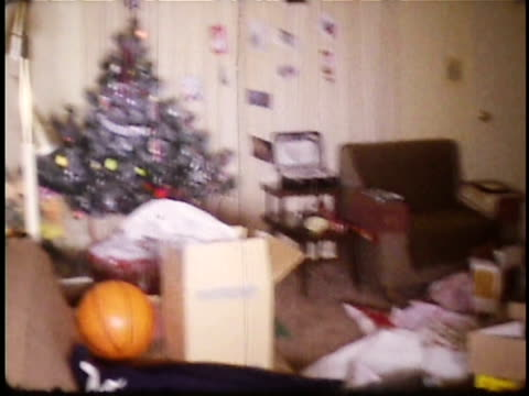 1960s ws pile of empty christmas gift boxes in room / usa - 1960 stock videos & royalty-free footage