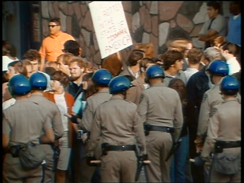 1960s pan policemen in helmets blocking crowd of protesters at peace demonstration - peace demonstration stock videos and b-roll footage
