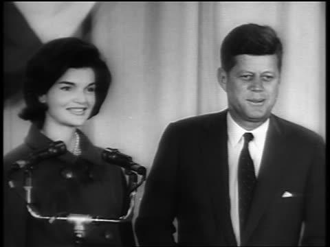 b/w 1960s president john f kennedy jacqueline kennedy standing on stage smiling - jacqueline kennedy stock videos and b-roll footage