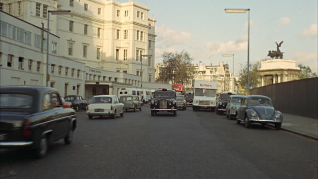 1960s WS REAR POV Street traffic / London, UK