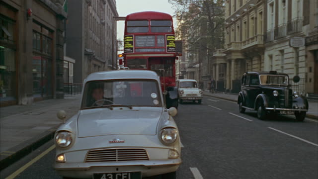 1960s ws rear pov street traffic with cars and double-decker buses / london, uk - 1965 stock videos & royalty-free footage