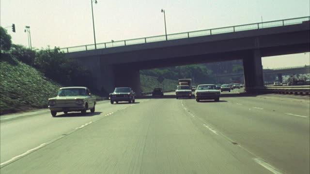 1960s WS REAR POV Traffic on Los Angeles highway / California, USA