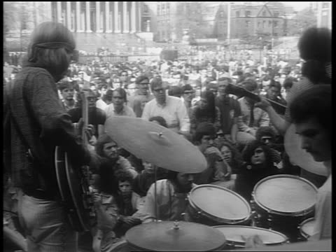 1960s rear view grateful dead performing for audience at columbia university / zoom in - rocking stock videos & royalty-free footage