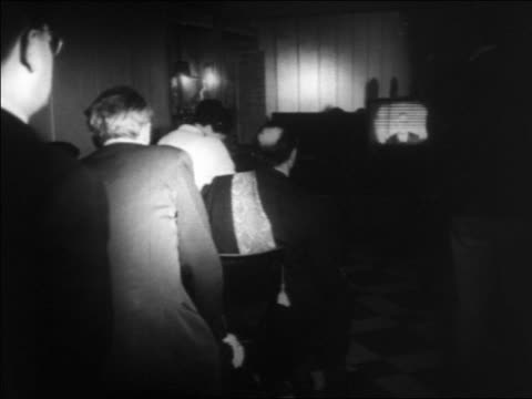 b/w 1960s rear view people watching charles de gaulle's television speech about algerian problem - charles de gaulle stock videos and b-roll footage