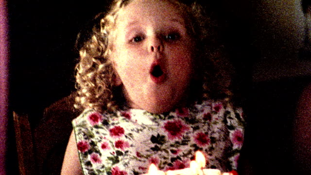 1960s reenactment close up pan grainy girl + woman blowing out candles on birthday cake - birthday candle stock videos & royalty-free footage