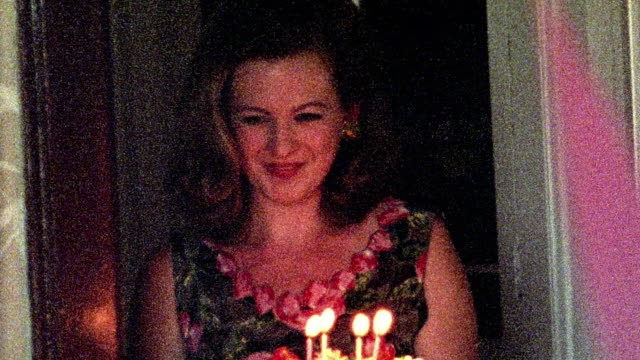 1960s reenactment close up grainy woman carrying lit birthday cake through doorway - 1965 stock videos & royalty-free footage
