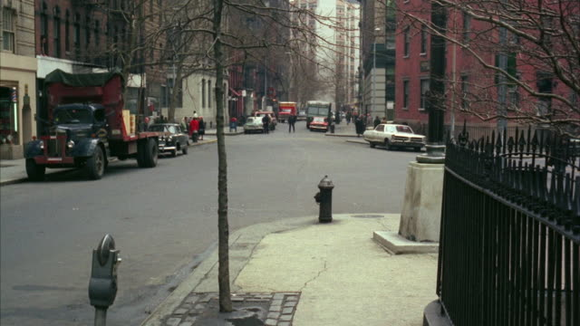 1960s ws residential district road intersection - anno 1968 video stock e b–roll