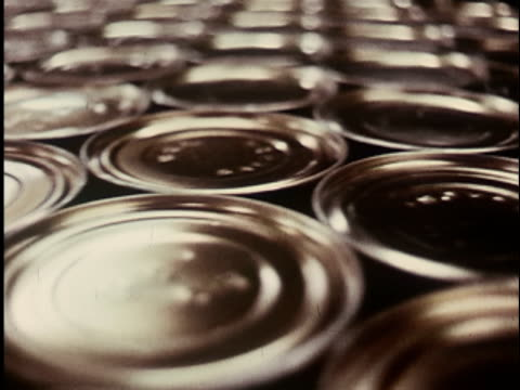 1960s cu, selective focus, pan, rows of cans in food processing plant, bristol bay, alaska, usa - canning stock videos & royalty-free footage