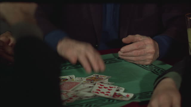 vídeos y material grabado en eventos de stock de 1960s cu td tu senior man playing cards - carta naipe