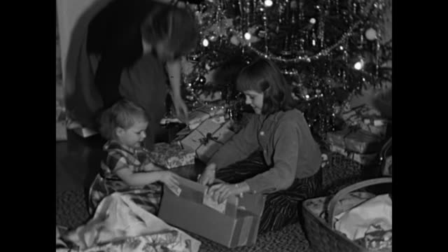 1960s sisters open christmas gifts by tree -  home movies - unwrapping stock videos & royalty-free footage