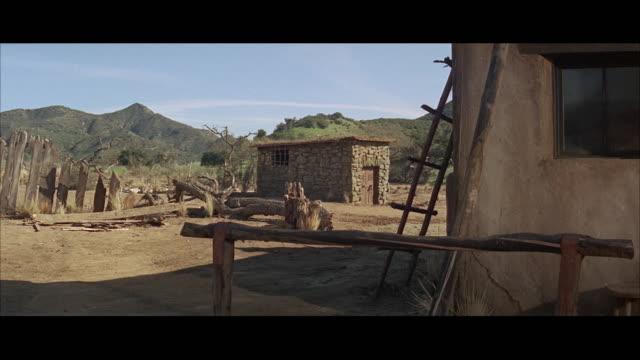 1960s ws small stone jail house - wilder westen stock-videos und b-roll-filmmaterial