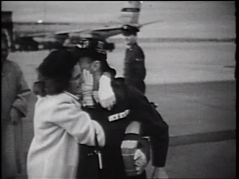 b/w 1960s soldier woman walking while hugging kissing / vietnam war homecoming / ca - girlfriend stock videos & royalty-free footage