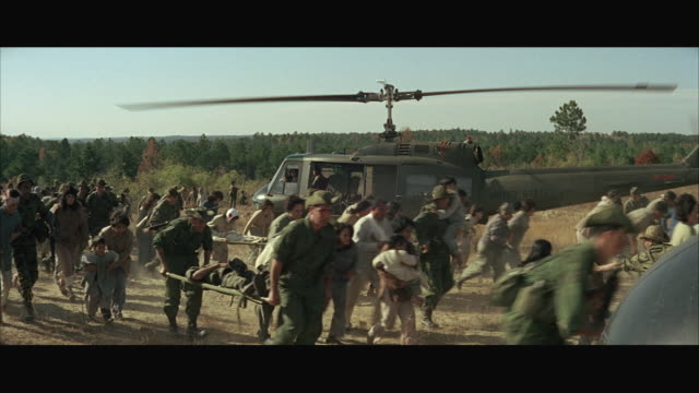 1960s WS PAN Soldiers in military helicopters rescuing wounded civilians