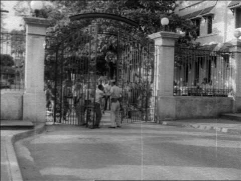 b/w 1960s soldiers manning gates against crowd during revolution / dominican republic / newsreel - イスパニョーラ点の映像素材/bロール