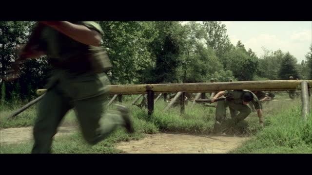 1960s ws soldiers training on obstacle course at army camp - obstacle course stock videos & royalty-free footage