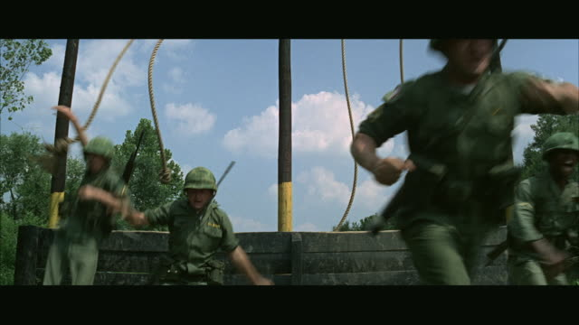 vidéos et rushes de 1960s ws soldiers training on obstacle course at army camp - soldat