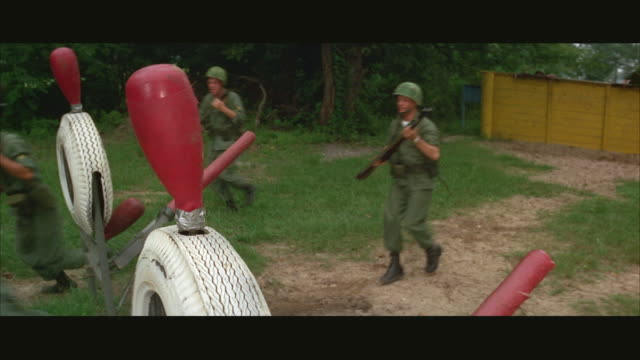 1960s ms soldiers training on obstacle course at army camp - 障害物コース点の映像素材/bロール
