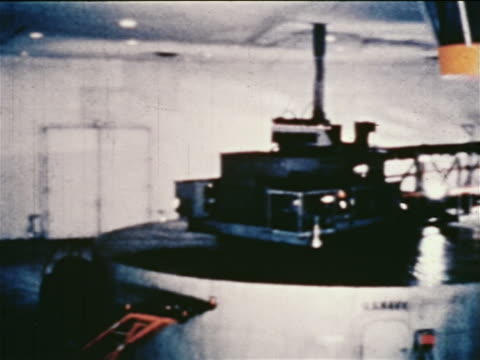 1960s spinning centrifuge used for astronaut training (g-force test) / newsreel - g force stock videos & royalty-free footage