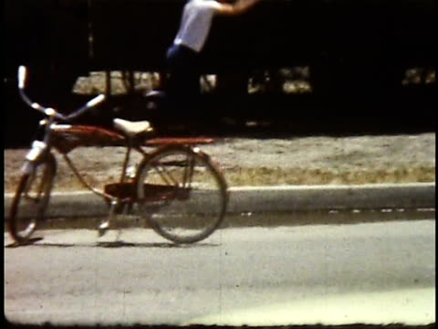 1960s ws pan teenage boy long jumping on sidewalk / lompoc, california, usa - männlicher teenager allein stock-videos und b-roll-filmmaterial