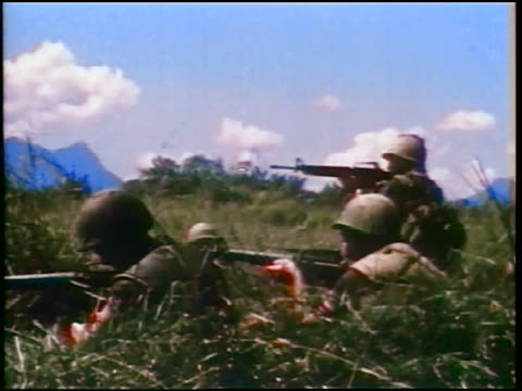 1960s three soldiers shooting m16 rifles in field / vietnam war / documentary - m16 stock videos & royalty-free footage