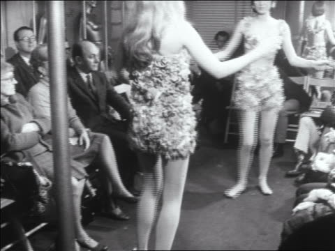 b/w 1960s tilt down 2 women in flowered outfits dance in fashion show - bikini top stock videos & royalty-free footage