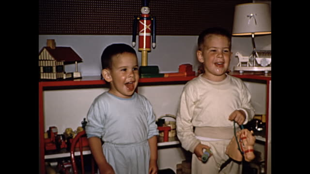 1960s - toddler boys playing with toys in bedroom - model aeroplane stock videos & royalty-free footage