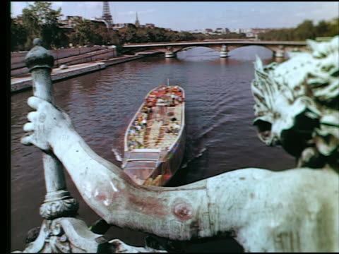 1960s tour boat on seine river / tilt up pont des invalides + eiffel tower in background / statue in foreground / paris - river seine stock videos & royalty-free footage