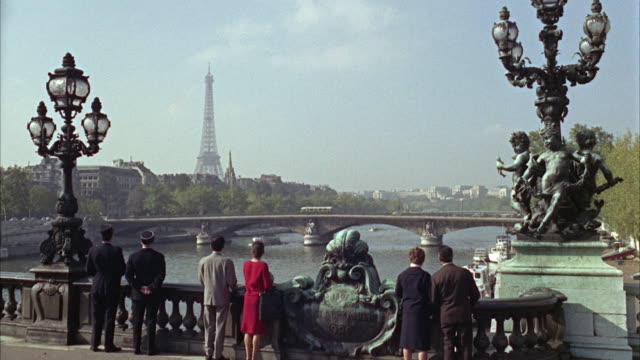 1960s ws tourists looking at cityscape from bridge / paris, france - river seine stock videos & royalty-free footage