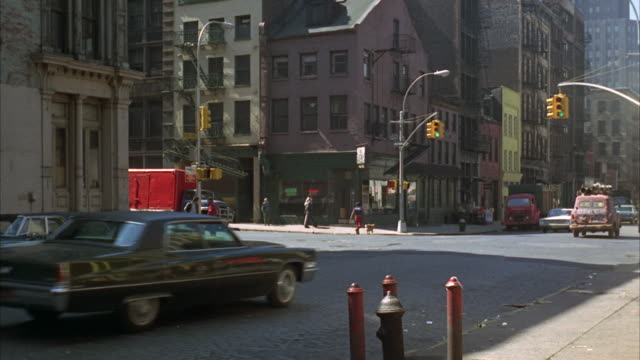 1960s ws traffic in residential area / new york city, usa - anno 1968 video stock e b–roll