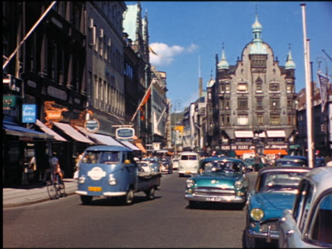 1960s traffic + people on busy city street / Denmark