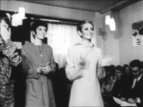 b/w 1960s twiggy two other models clapping at fashion show / newsreel - twiggy fashion model stock videos and b-roll footage
