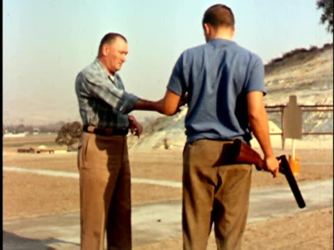 MONTAGE 1960s Two men with shotgun, aiming at target, California / USA