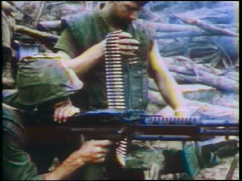 1960s two soldiers shooting m60 machine gun / vietnam war / documentary - schlacht stock-videos und b-roll-filmmaterial