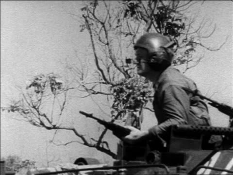 b/w 1960s us marine with gun on moving transport during revolution / dominican republic - イスパニョーラ点の映像素材/bロール