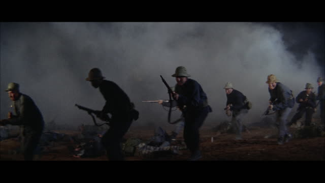 1960s ws viet cong soldiers during battle - ベトコン点の映像素材/bロール