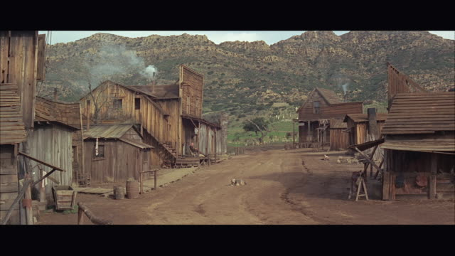 1960s ws western village with wooden houses - letterbox stock-videos und b-roll-filmmaterial